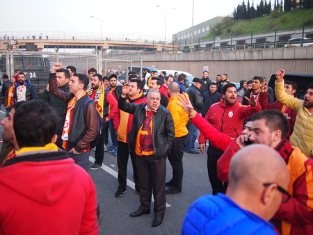 chant: Istanbul, Turkey - March 20, 2016: Angry Galatasaray fans chant after their match with Fenerbahce is postponed due to a bomb threat.