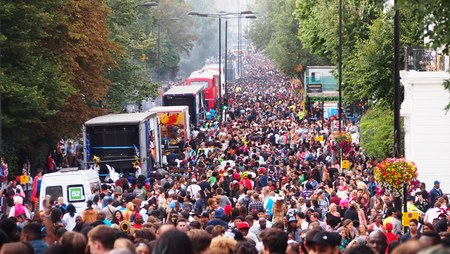 notting hill: London, UK - August 10, 2014: Crowds gather to dance, eat, and celebrate the Notting Hill Carnival.