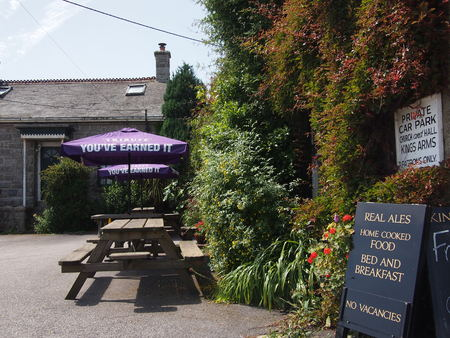 mousehole: Mousehole, Cornwall, UK - July 11, 2015: An English countryside pub in the sunshine Stock Photo