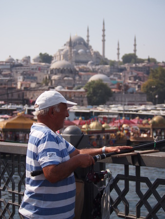 local 27: Istanbul, Turkey - September 27, 2015: Local fisherman at work on a sunny day on Galata Bridge in Istanbul. Editorial