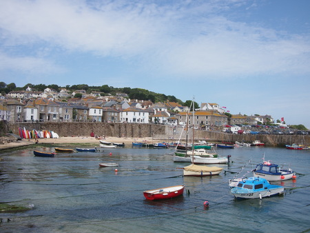 mousehole: Mousehole, Cornwall, UK - July 11, 2015: A small harbour in the Cornish village of Mousehole in the summer