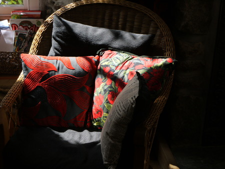 mousehole: Beams of light on chair and cushions