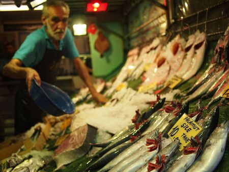 using senses: Istanbul, Turkey - September 26, 2015: A local fish vendor tops up the ice on his fresh fish at a food market on the Asian side of Istanbul.
