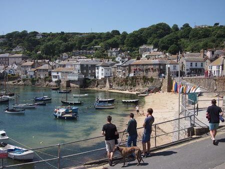 incidental people: Mousehole, Cornwall, UK - July 11, 2015: A small harbour in the Cornwish village of Mousehole in the summer