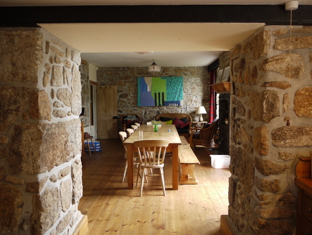 showcase interiors: A large wooden table in an English stone cottage Editorial