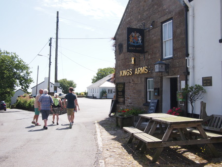 mousehole: Mousehole, Cornwall, UK - July 11, 2015: A family walks to the pub on a sunny day in the Cornish countryside