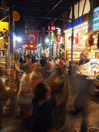 haggling: Istanbul, Turkey - September 28, 2015: Hundreds of tourists and locals rush through the Spice Market at night, haggling for the best price with the vendors.