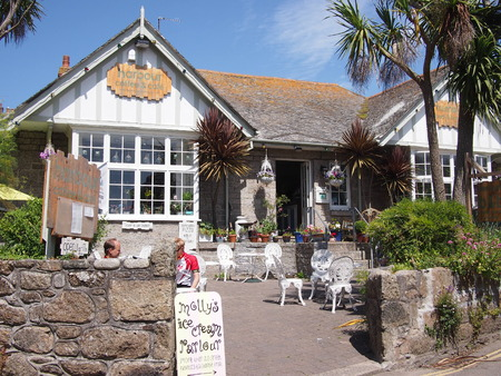 mousehole: Mousehole, Cornwall, UK - July 11, 2015: Cornwall cafe in the sunshine Editorial