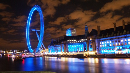 millennium wheel: London, UK - February 21, 2014: The River Thames and south bank illuminated on a cold winters night