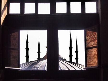 minarets: Mosque minarets through a window