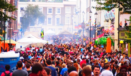 notting hill: London, UK - August 13, 2012: Crowds gather to dance, eat, and celebrate the Notting Hill Carnival.