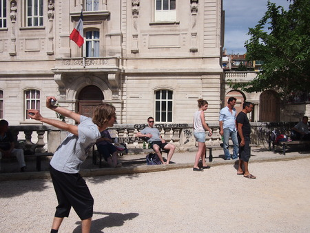 bocce: Marseille, France - June 10, 2016: A group of young people play boules in the park