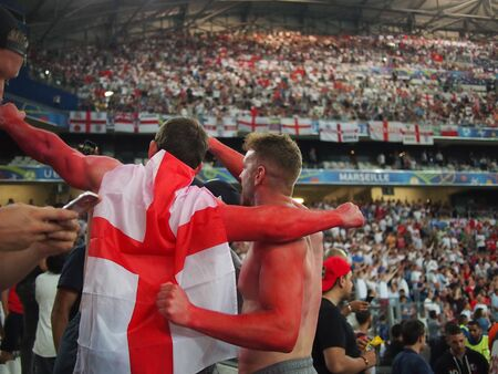 clashes: Marseille, France - June 11, 2016: England fans in body paint watching the 1-1 draw with Russia at Euro 2016. Clashes with police, Marseille and Russian fans dominated the headlines.