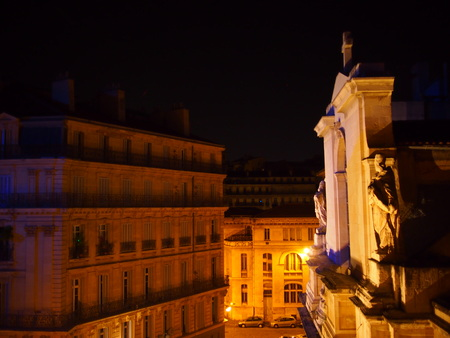 Traditional French residential building at night