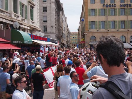 clashes: Marseille, France - June 11, 2016: England fans supporting their team in the infamous 1-1 draw with Russia at Euro 2016. Clashes with police, Marseille and Russian fans dominated the headlines.