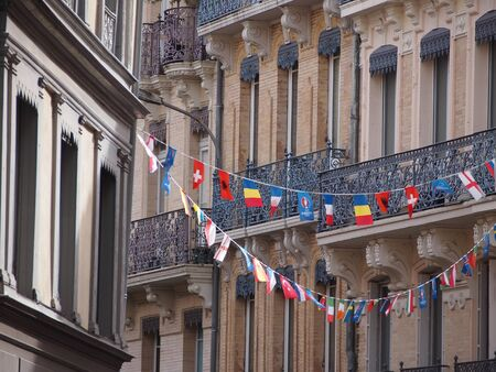 narrow street: Colourful flags in Toulouse old town celebrating Euro 2016