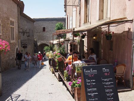 june 25: Carcassonne, France - June 25, 2016: Carcassonne town centre in summer Editorial