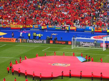 despite: Paris, France - June 27, 2016: Spain fans cheer on their team despite losing 2-1 to Italy in Paris