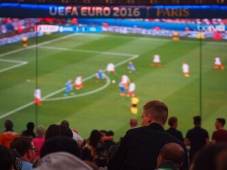 big screen tv: Paris, France - June 27, 2016: Fans watch England lose to Iceland at the iconic fan zone underneath the Eiffel Tower