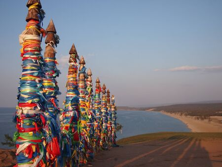 shamanism: Sunset over prayer flags in Khuzir on Olkhon Island in Siberia Stock Photo