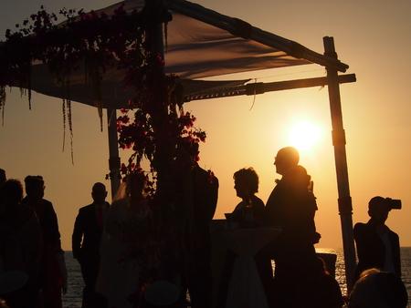 Tel Aviv, Israel - 04 June, 2017: Silhouette of a chuppah at a Jewish wedding ceremony on the beach near Tel Aviv at sunset Editorial