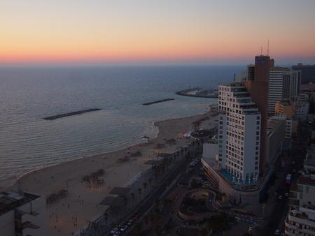 Tel Aviv, Israel - 06 June, 2017: Sunset over Tel Aviv city centre and its beaches.