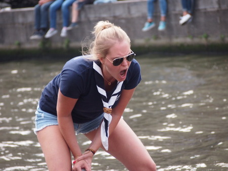 Ghent, Belgium - 26 August 2017: Female cox shouting instructions to her crew