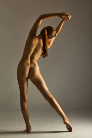 nudity woman: nude woman stretching Stock Photo