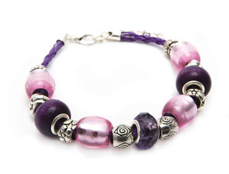 Handmade jewellery pink & violet isolated  Stock Photo - 10644051