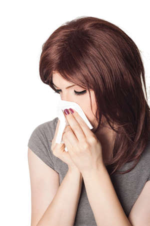 grippe: Chilled woman blowing her nose Stock Photo