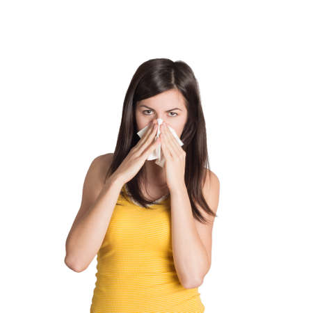 distemper: Chilled woman blowing her nose Stock Photo