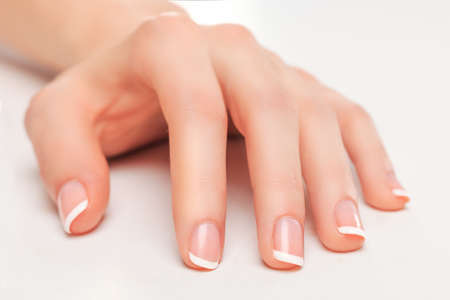 Beauty salon nails french manicure Stock Photo