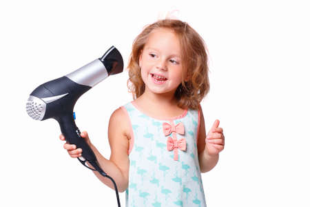 Girl drying her hair Stock Photo