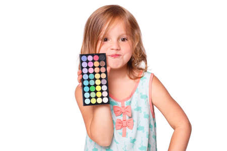 maturing: A child - Young Girl showing eyeshadows