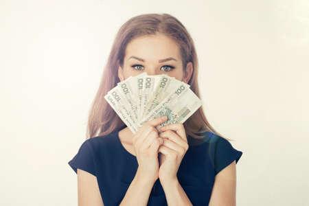 Young woman holds cash - Polish money - shopping, finances, loans