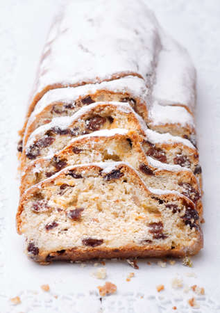 christma: Christmas stollen as closeup on a wooden board. Stock Photo