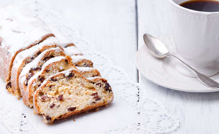 ambiance: Christmas stollen as closeup on a wooden board. Stock Photo