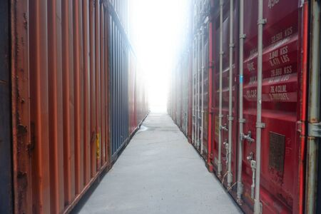 Front view of container stack Shining end Stock Photo