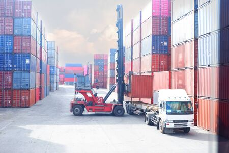 Container handlers in the harbor Work for import and export Stock Photo