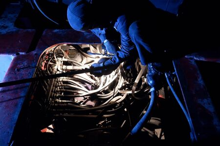 The mechanic is repairing the engine. at night Stock fotó