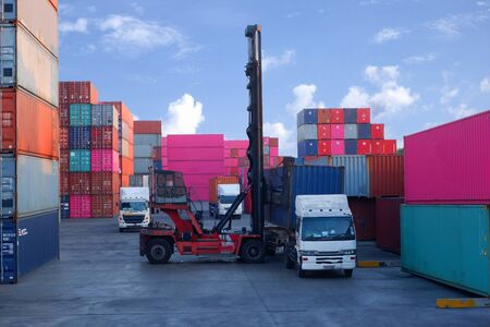 Container handlers Load the container into the truck Stock Photo