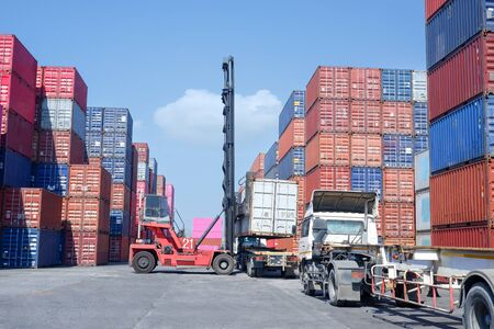 Logistics and transportation of harbor, container truck, container forklift, the concept of export and import in transportation International trade Imagens