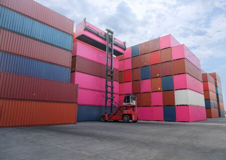 Logistics and transportation of harbor, container truck, container forklift, the concept of export and import in transportation International trade Stock Photo