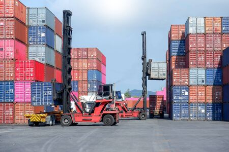 Container stacker, load the container into the truck. Transportation concept Stock Photo