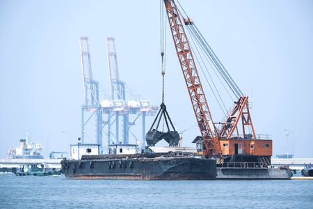 Sand tanker at the sand loading station with loader