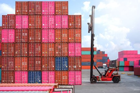 Container handlers and trucks In the loading and unloading yard