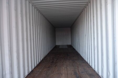 Inside empty dry high cube container with wooden floor