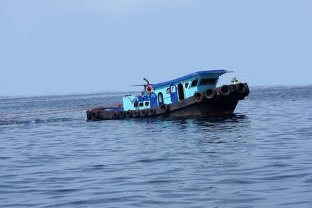 Tug boat sailing at sea