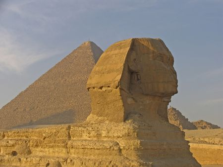 The Sphinx with Pyramid of Giza in the backgound Stock Photo