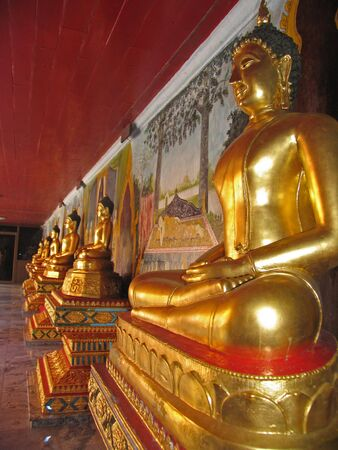 Row of Buddha Statues in Thailand photo